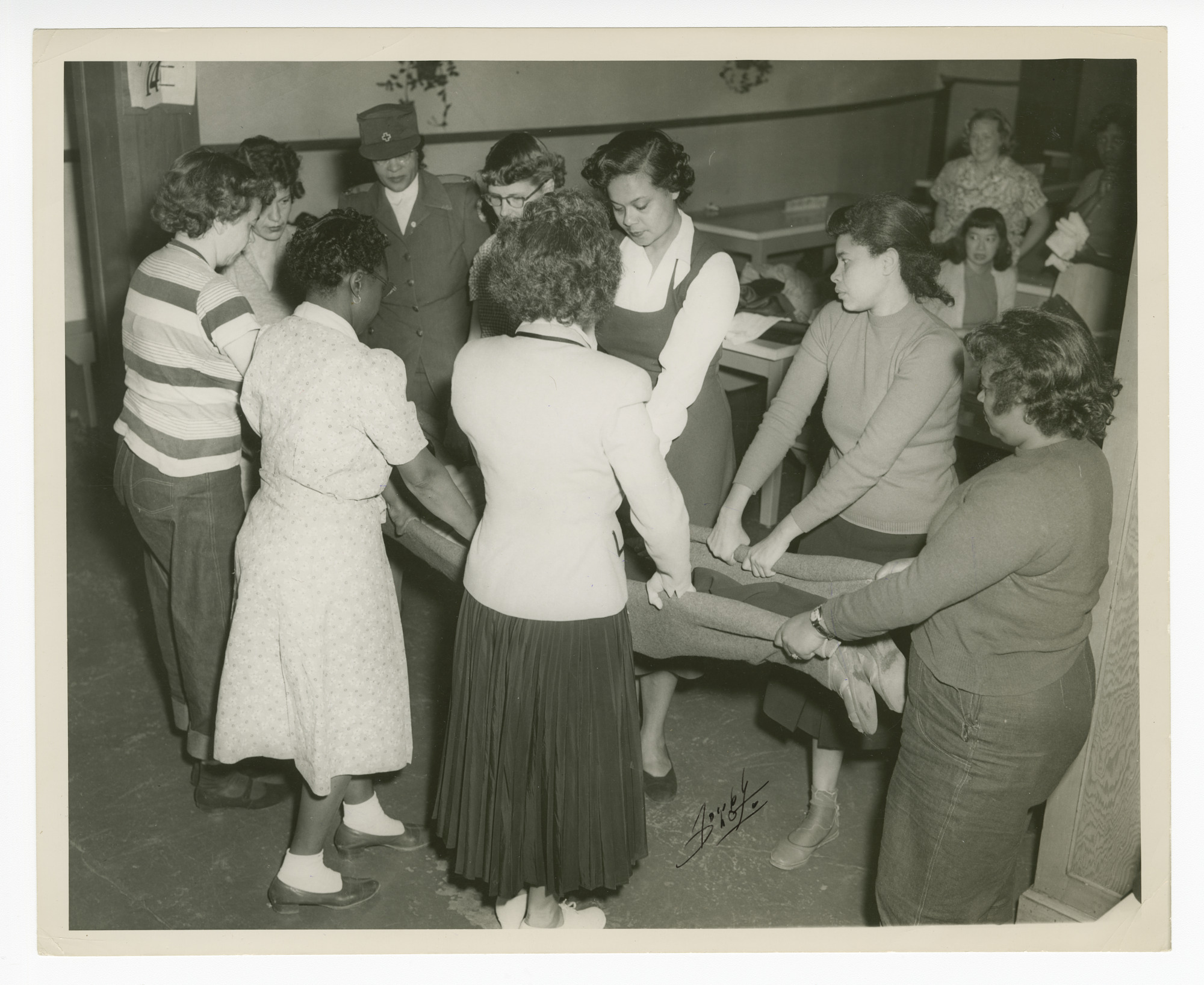Photograph of Frances Albrier teaching first aid