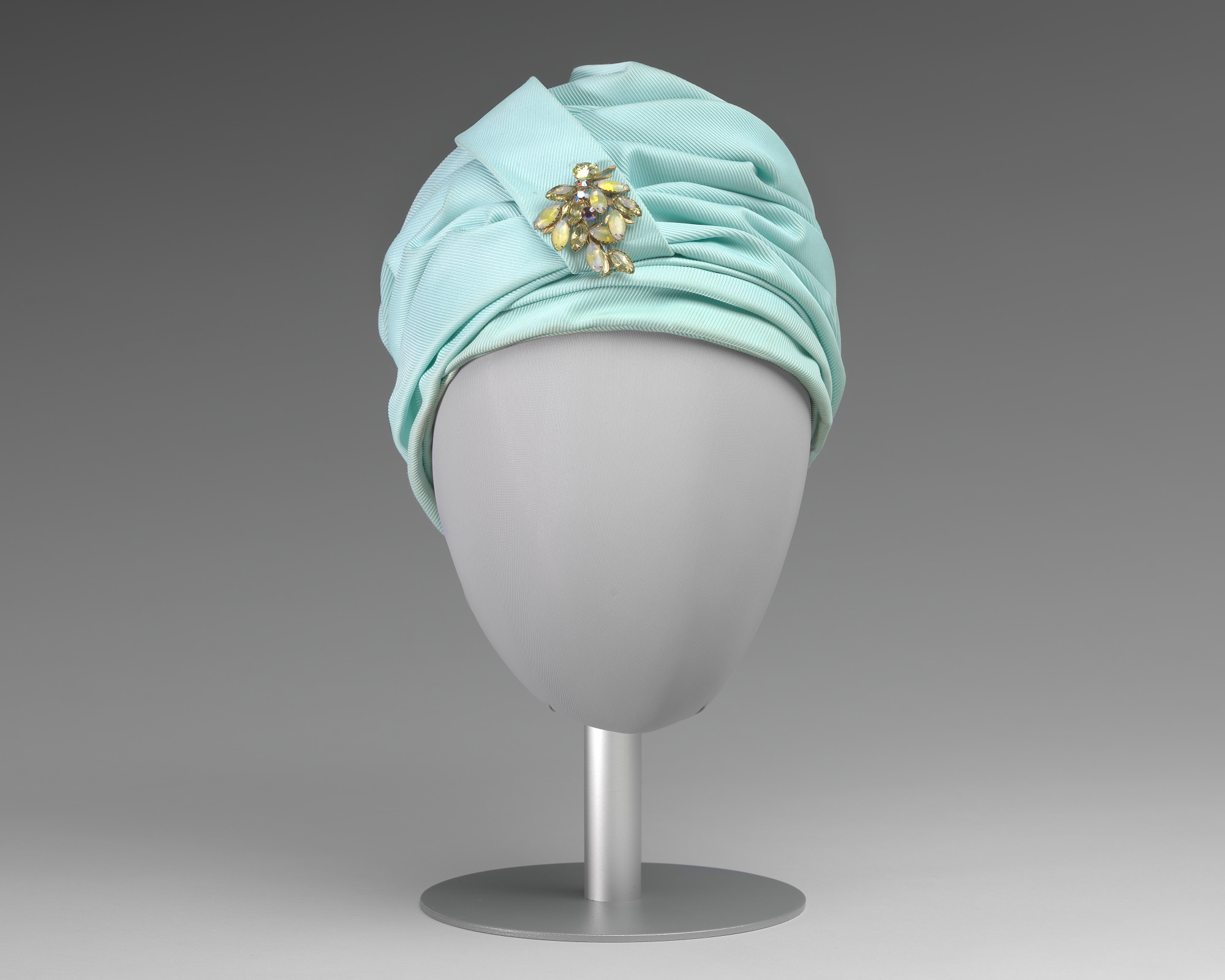 Turqouise turban style hat with brooch from Mae's Millinery Shop