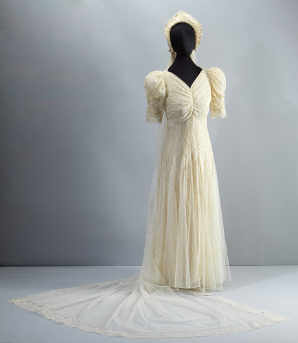 Wedding dress worn by Lollaretta Pemberton with veil and headpiece ...