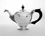 Silver teapot with etching and black handle