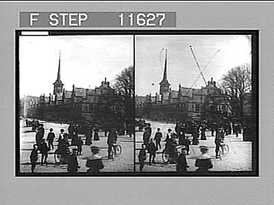 Danish people coming and going before the picturesque Exchange with its spire of dragons, Copenhagen. 1022 Photonegative