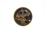 Black and Gold Metal Button Depicting Two Umbrellas, One Open and One Closed