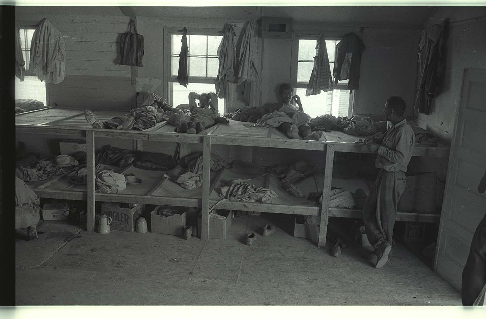 Braceros spend their leisure time in a living quarter on a camp near McAllen, Texas.
