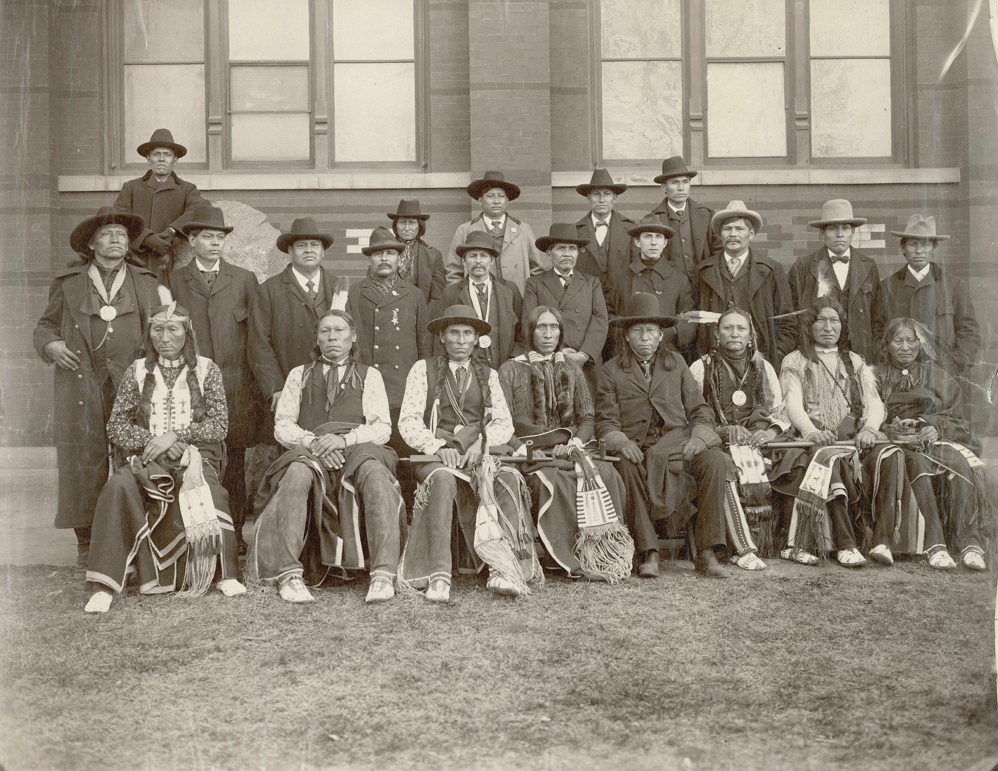 Group of Chiefs, Some in Partial Native Dress, Two with Benjamin Harris Peace Medals, One with James Garfield ? Peace Medal, Outside Smithsonian Arts & Industry Museum JAN 1899