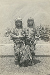 Two Young Women in Costume with Headgear 1902