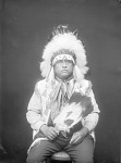 Portrait (Front) of Sate Motay (Bear Paw), Called George Hunt, in Partial Native Dress with Headdress and Holding Fan MAY 1924