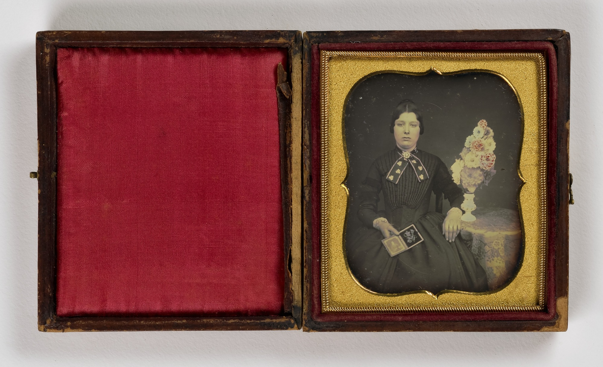 Untitled (Woman Holding Open Daguerreotype)