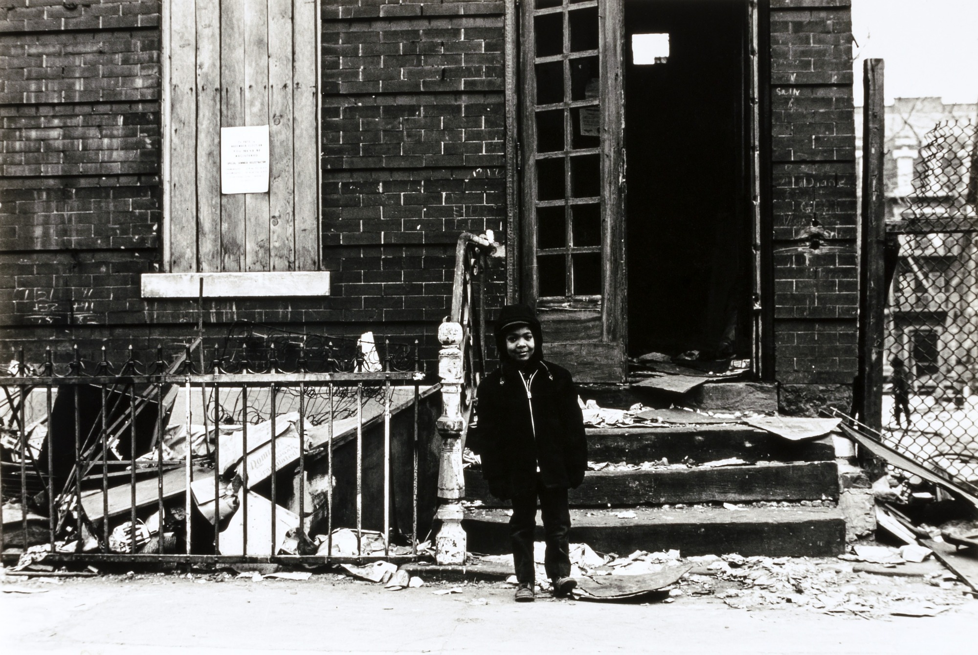 Untitled (Boy in front of condemned building, East New York)