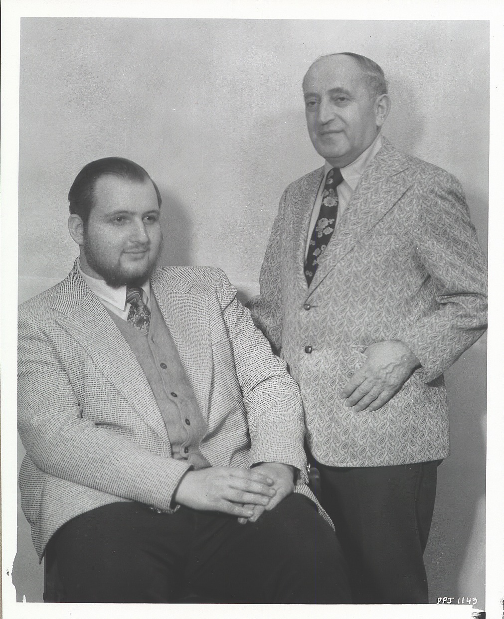 Ari M. Roussimoff with unidentified man [photograph] / (photographed by Peter A. Juley & Son)