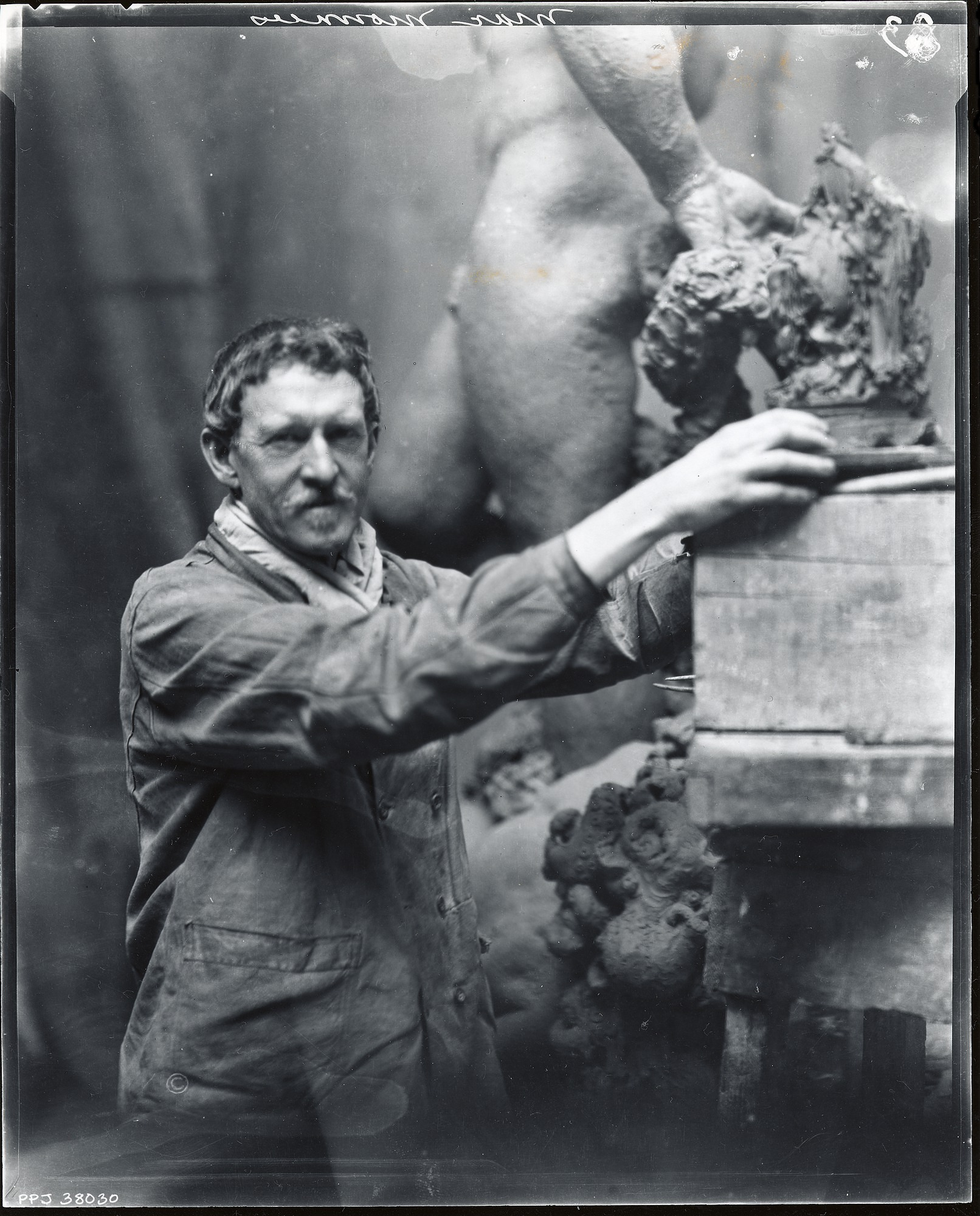 Frederick MacMonnies in his studio [photograph] / (photographed by Peter A. Juley & Son)