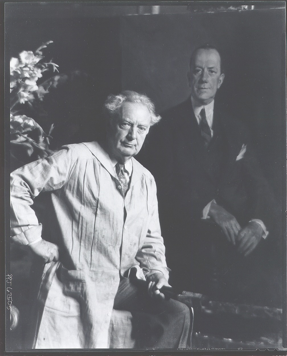 Howard Chandler Christy in his studio with a painting [photograph] / (photographed by Peter A. Juley & Son)