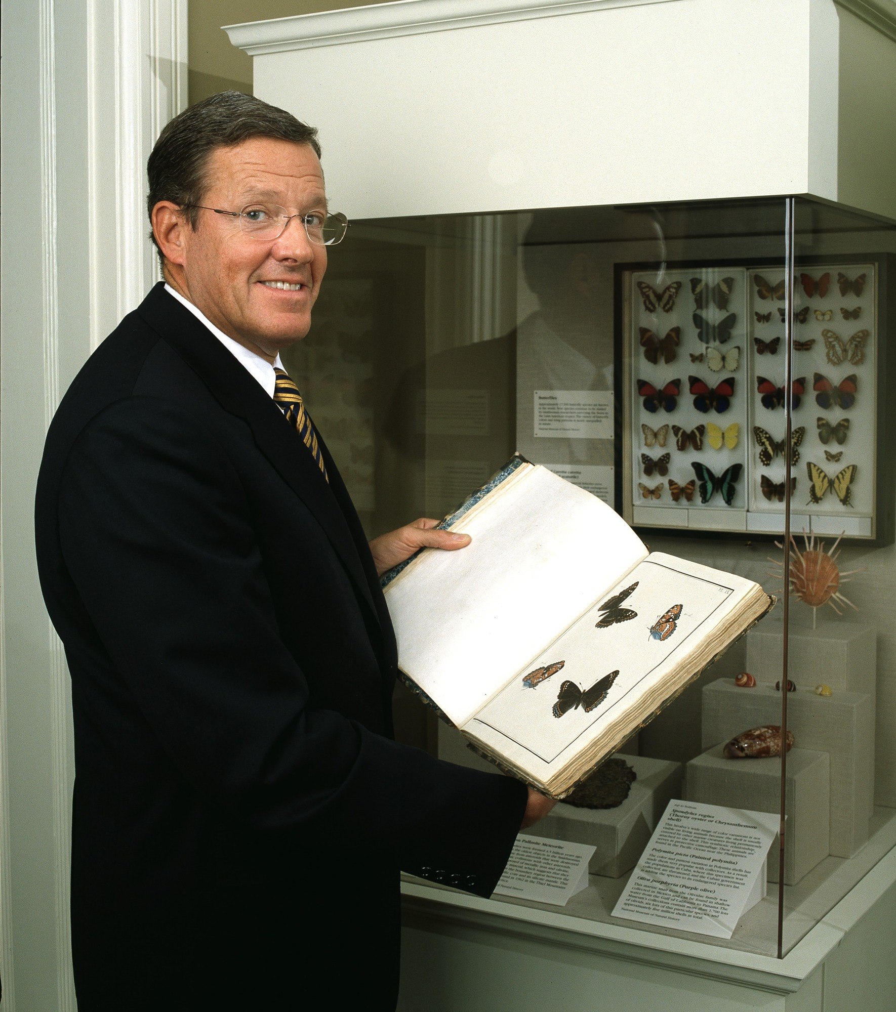 Secretary Small with Rare Book from SI Libraries