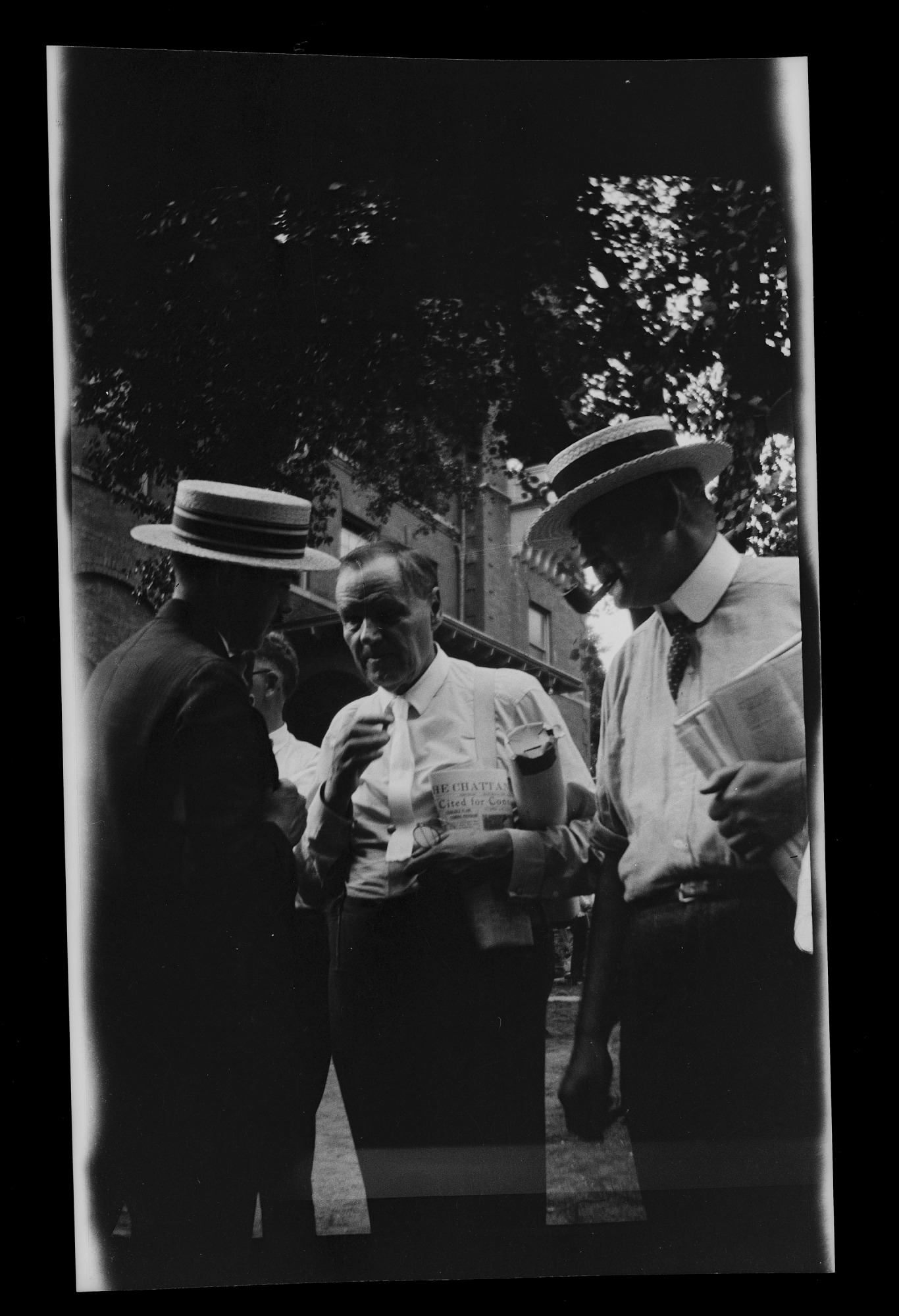 Clarence S. Darrow (center) standing near Rhea County Courthouse with unidentified man (left) and Ar