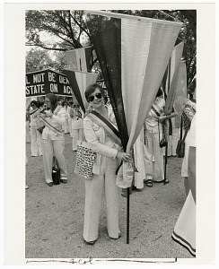 Image of Edith Mayo with 1913 Suffrage March Banner at Alice Paul Memorial March in Washington, D.C.
