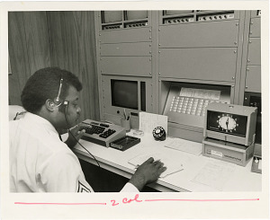 Image of Control Room Operator Jim Wooten Checks New Alarm System