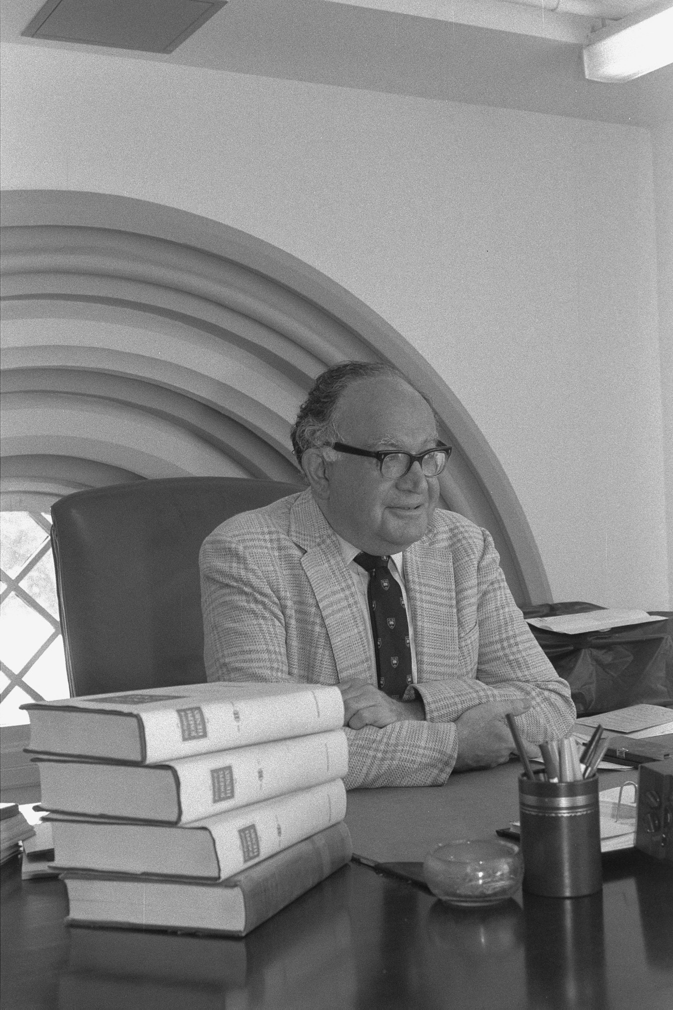 Nathan Reingold, Editor, The Joseph Henry Papers Project, at his desk in the Smithsonian Institution Building, 1984, by Jeff Tinsley. Smithsonian Institution Archives, negative number 85-13061-21A.