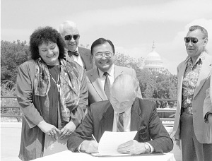 Image of Secretary Adams at Signing Ceremony NMAI