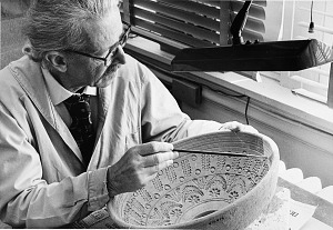 Image of Preparator Andreas Joseph Andrews Works on a Pottery Bowl