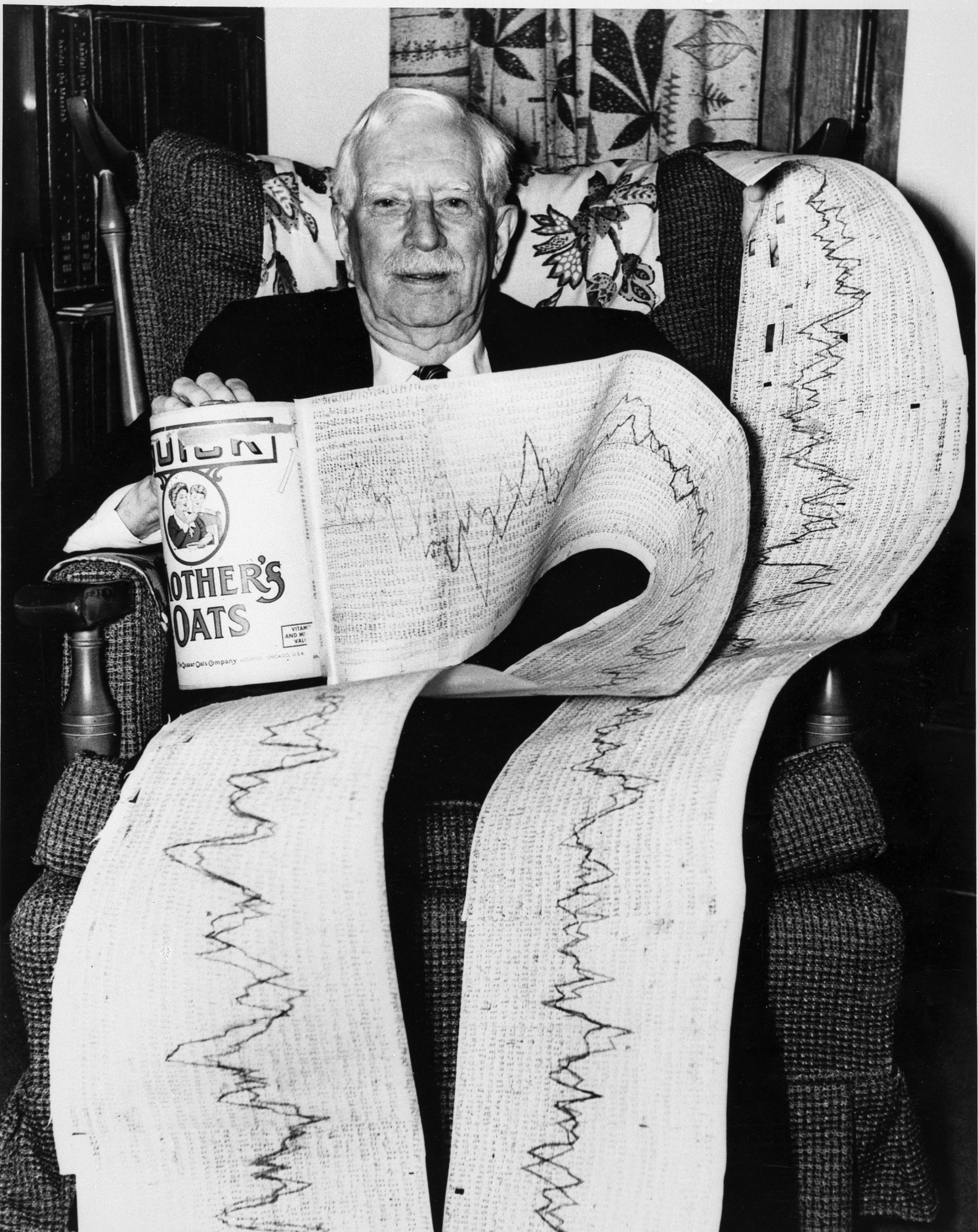 Secretary Abbot with Printouts, by Unknown, c. 1968, Smithsonian Archives - History Div, 94-4039.