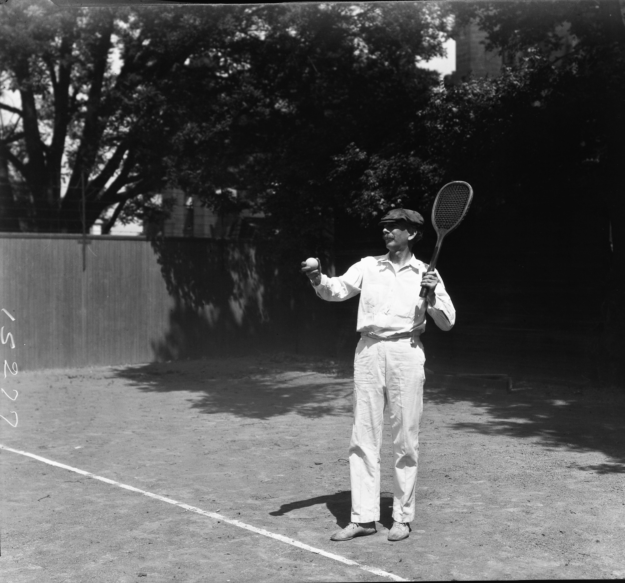 Secretary Charles G. Abbot Playing Tennis
