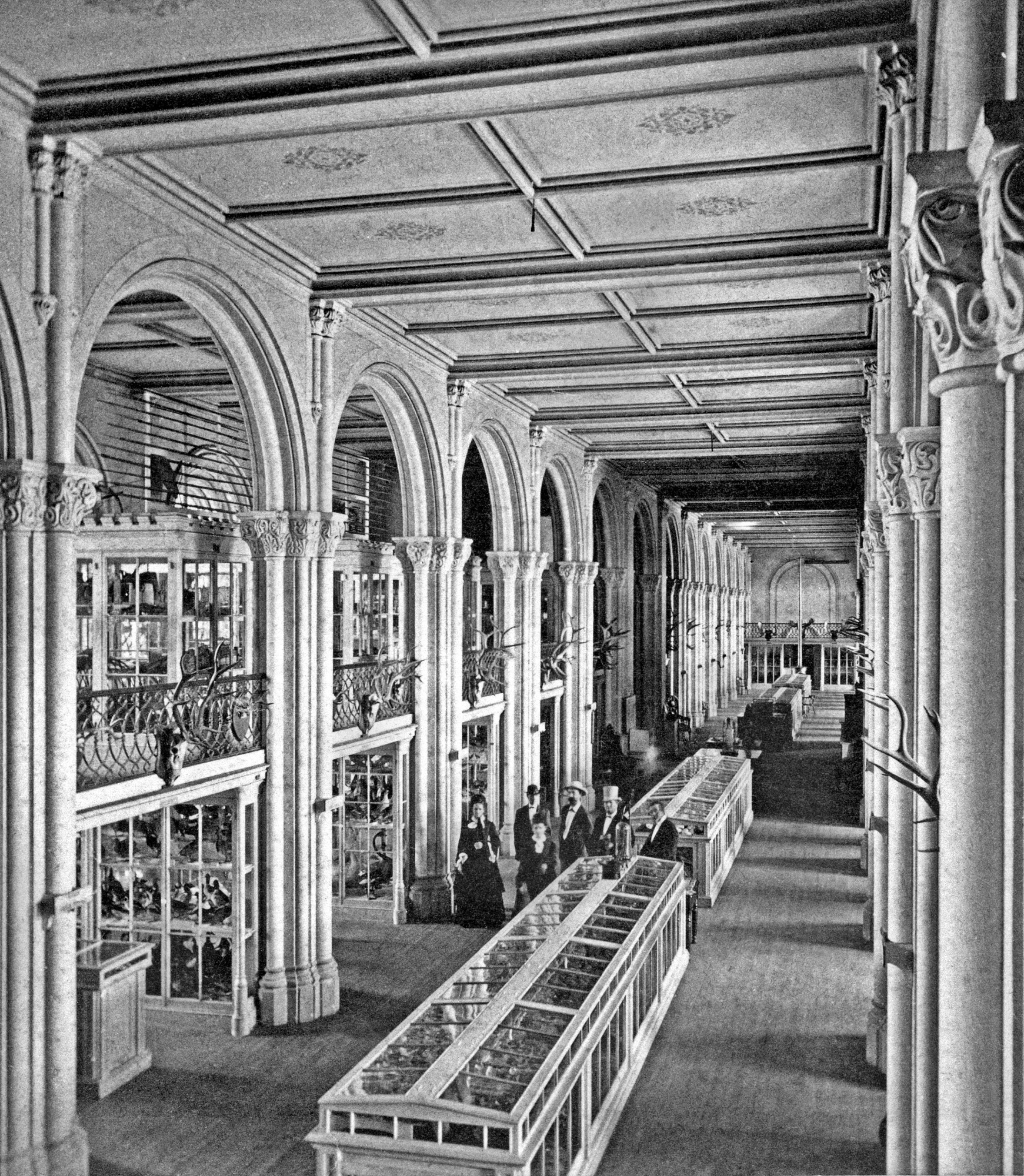 Photograph of visitors to the Museum in the Smithsonian Institution Building is probably by Thomas Smillie, 1867. Smithsonian Institution Archives, negative number MAH-60144A.