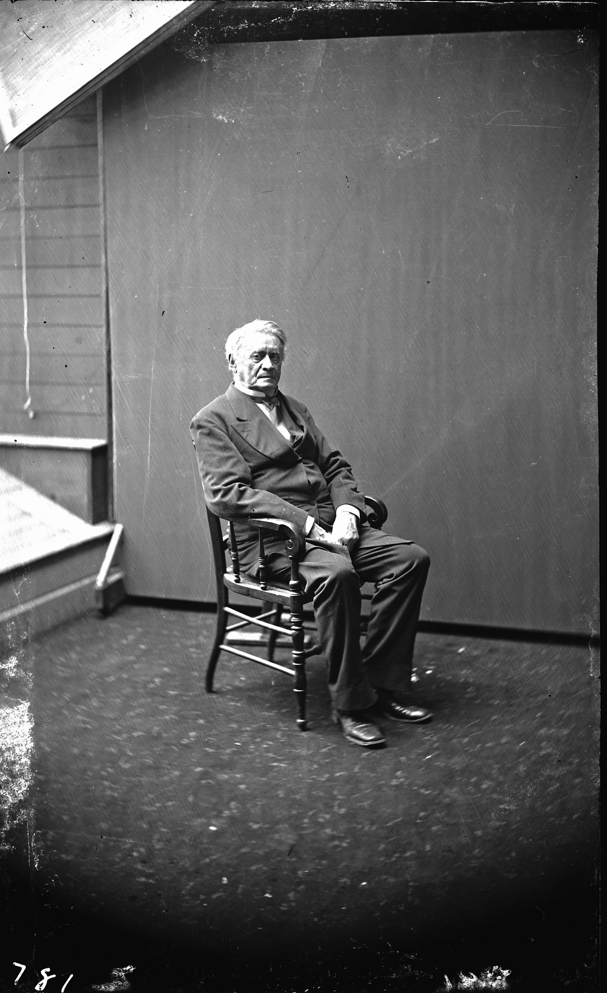 Joseph Henry (1797-1878), physicist and first Secretary of the Smithsonian Institution from 1846 to 1878, seated in a chair, c. 1870s. Smithsonian Institution Archives, negative number mah-781