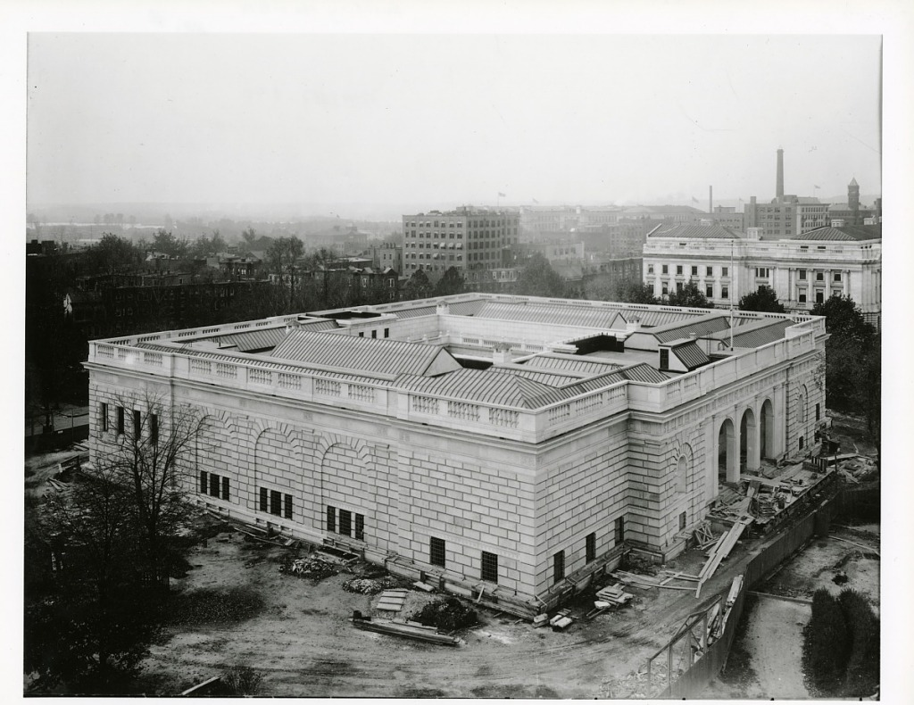 Black and white aerial view of the Freer Gallery, surrounded with remaining construction rubble.
