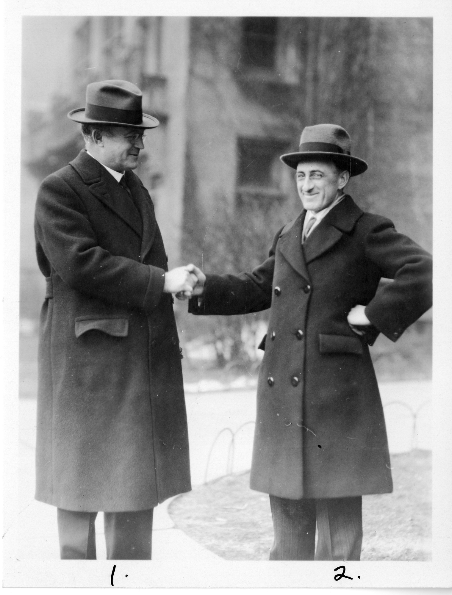 Preview of Henry Gordon Gale (left), shaking hands with Arthur Jeffrey Dempster (right)