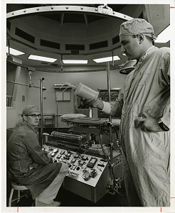 Image of Theodor Kolobow (right), holding a new heart-lung machine, and unidentified man (left)