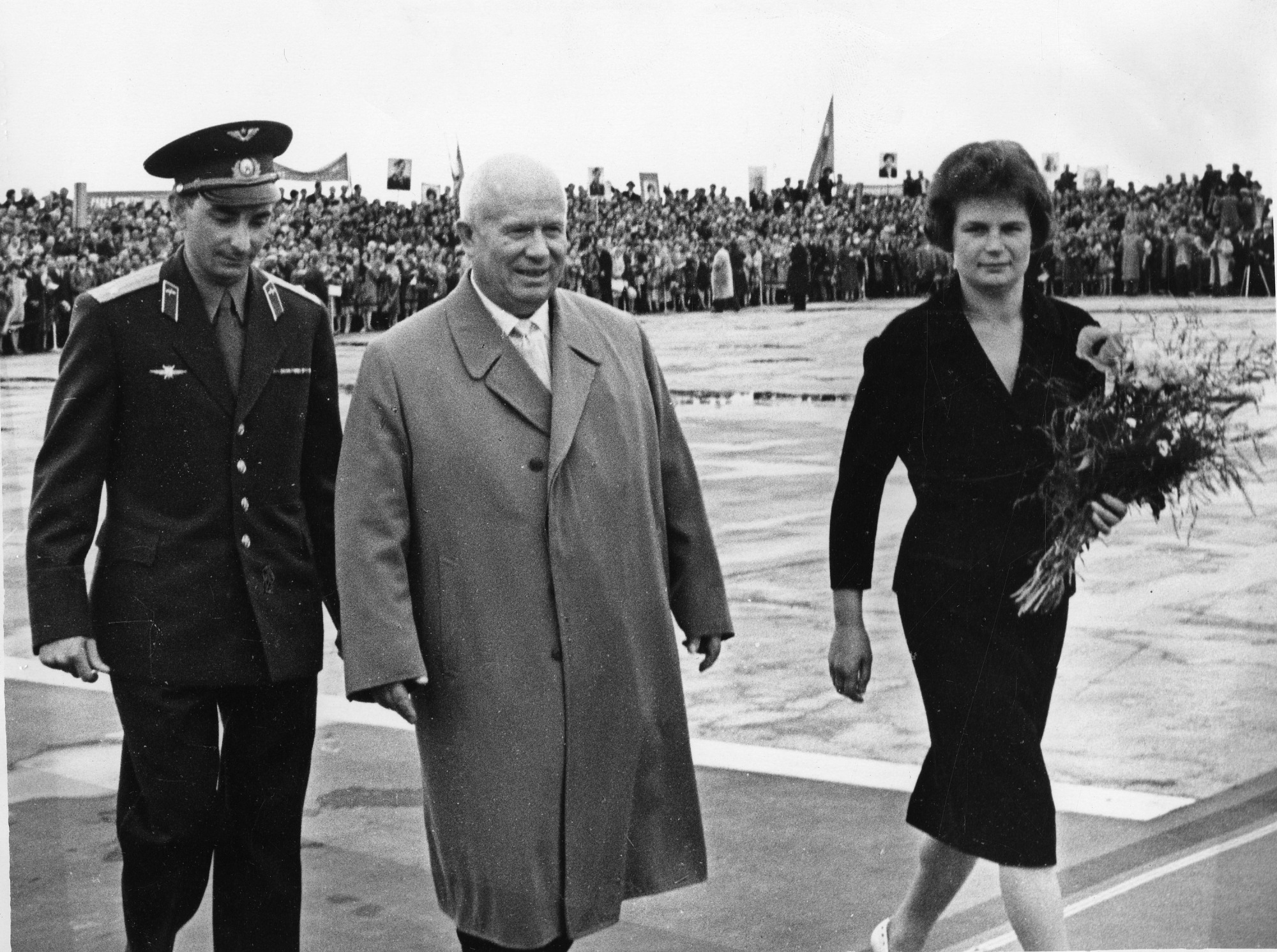 Preview of left to right: unidentified man, Nikita Khrushchev (1894-1971), and Valentina Vladimirovna Nikolayeva-Tereshkova (b. 1937)