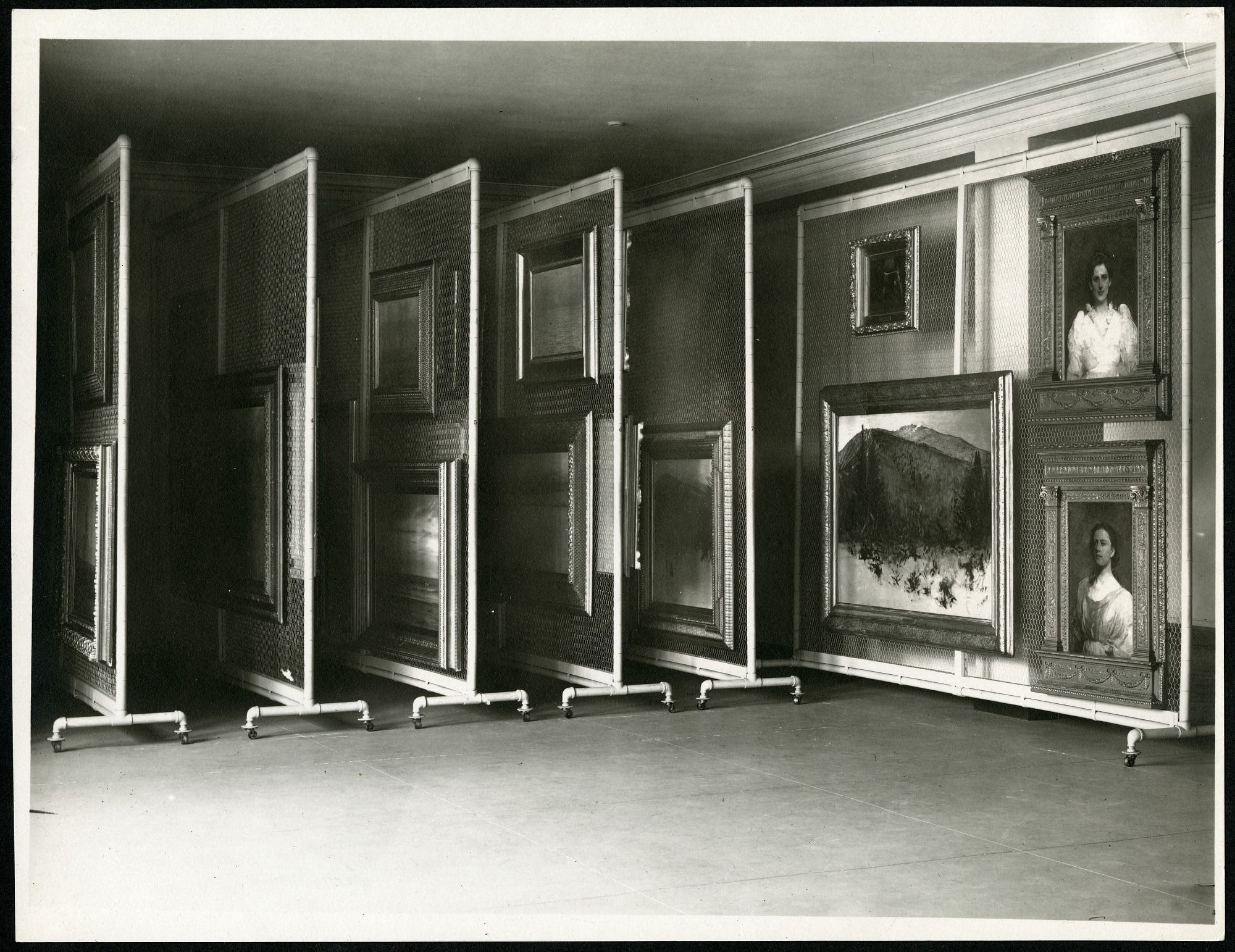 Preview of Photograph of American Paintings Hanging on Rolling Storage Racks