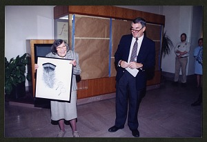 Image of Roxie Laybourne Holding Feather Illustration at Opening of the