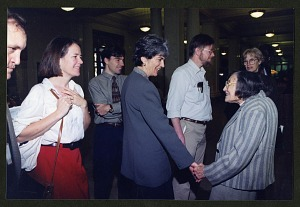 Image of Roxie Laybourne greeting attendees of the
