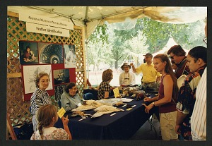 Image of Roxie Laybourne and Carla Dove at the Feather Identification Table on the Mall for the Smithsonian's 150th Anniversary Celebration