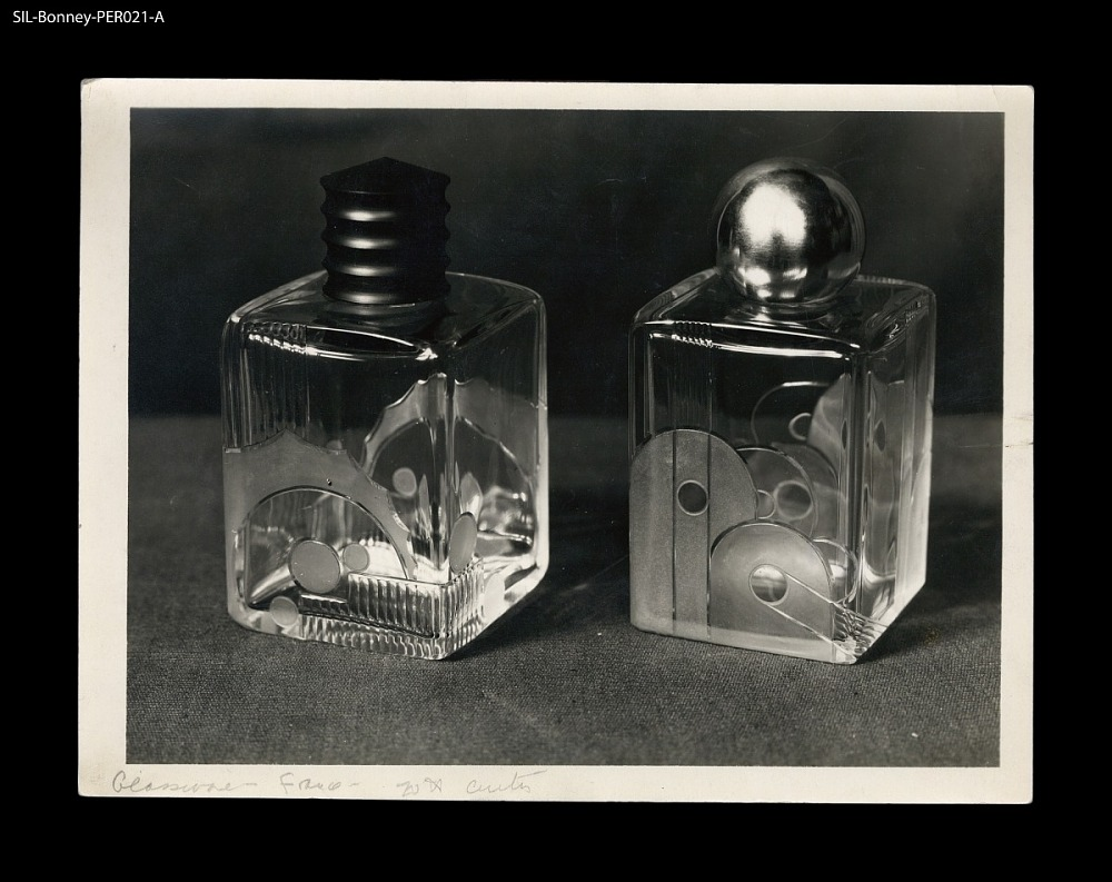 Perfume bottles  France, ca  1926  Clear and frosted circle