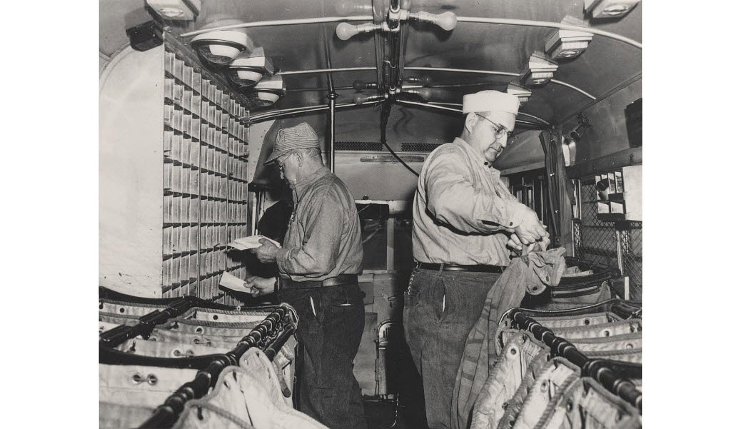 Photograph of Highway Post Office clerks at work on bus
