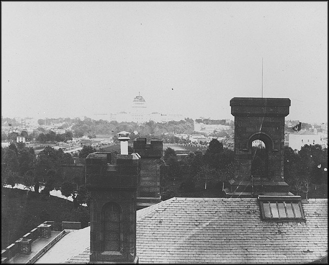 View from the Smithsonian Institution Building or Castle roof looking east toward the US Capitol, 1860s
