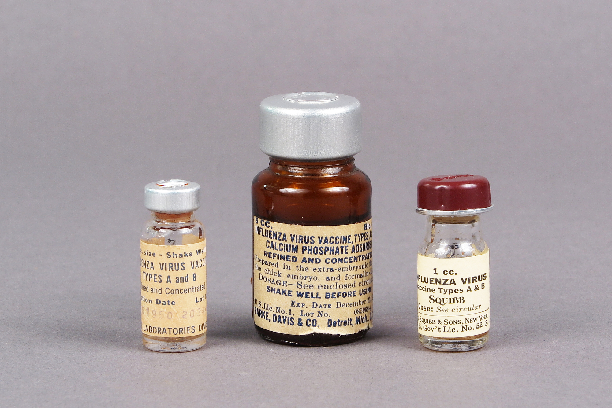 Three examples of early Influenza Virus Vaccine, Types A and B, 1945-1952, made by Lederle Laboratories, Parke, Davis and Co., and E. R. Squibb & Sons.