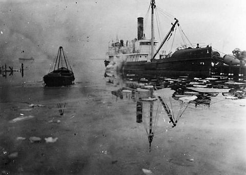 The <i>Oak</i> in an icy harbor