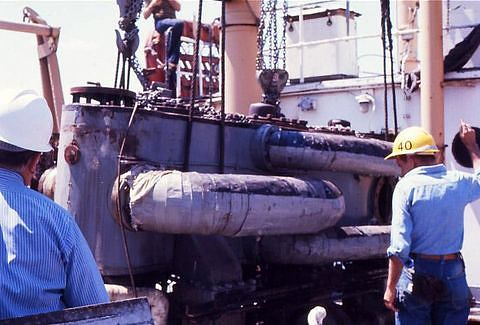 The engine is lifted out of the hull.