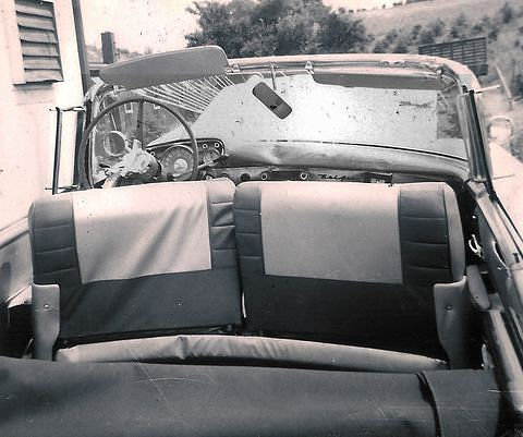 1957 Chevrolet with dents and cracks made by the driver and passengers in a collision