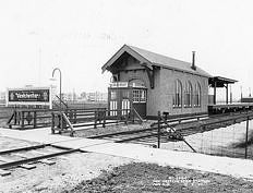 """View of the Canterbury """"L"""" station, Westchester, Illinois, December 1930."""