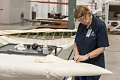 Museum Specialist Stitches Fabric on Curtiss Helldiver