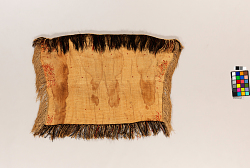 1 KOROWAI, FLAX CLOAK FRINGED, AND DECORATED WITH...