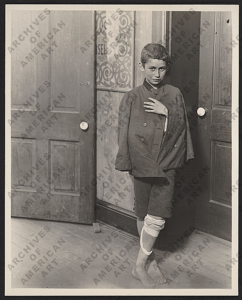 Waiting at the clinic by Lewis Hine