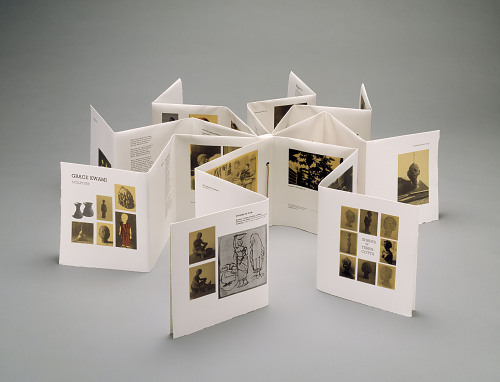 Grace Kwami Sculpture by Atta Kwami, London, 1993. The book folds out into a star pattern with the binding of the book int he middle and accordion pages with three segments for each ray of the star.