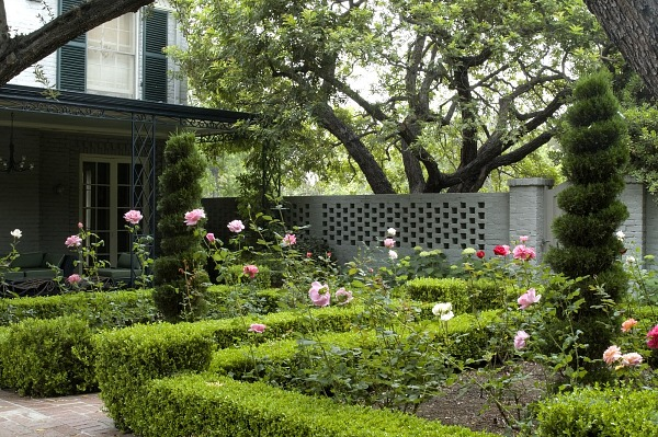 [Crawford-deZonia Garden] [photograph (digital)]: Formal rose gardens with topiary trees are teh first garden room inside the brick wall,  Date: 2000s
