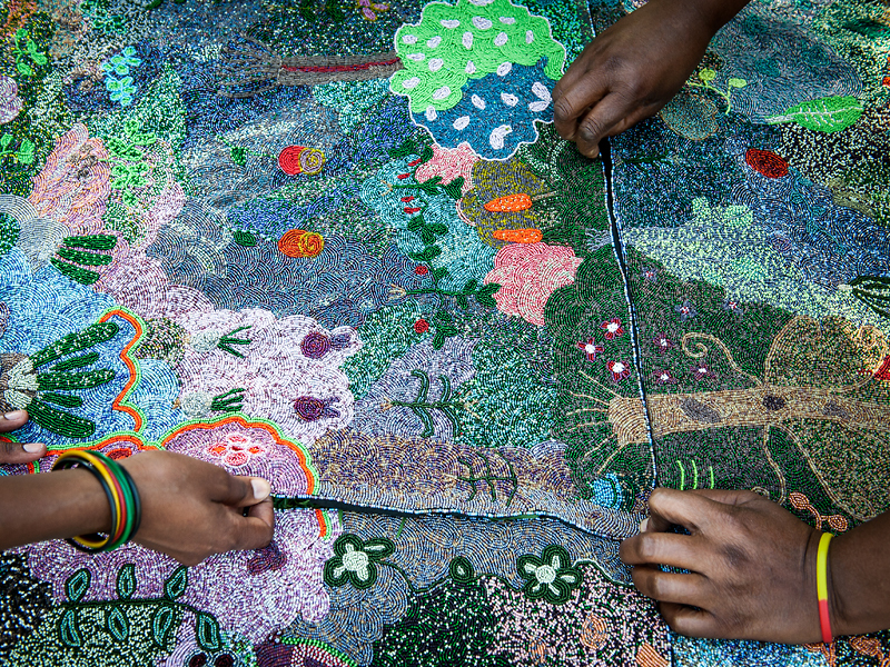 "The Ubuhle artists piece together the 4-panel ""The My Mother's Garden"" at Little Farm, Lidgetton, KwaZulu-Natal, South Africa."