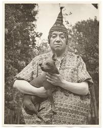 Diego Rivera holding a dog
