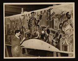 Marvin Beerbohm at work on a mural in a high school in Rochester, Michigan